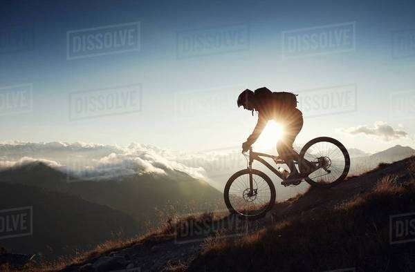 Mountain biker riding downhill, Valais, Switzerland Royalty-free stock photo