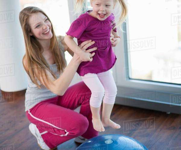 Girls playing with exercise ball in gym Royalty-free stock photo