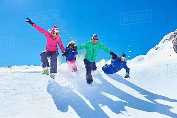 Family playing in snow, Chamonix, France Royalty-free stock photo