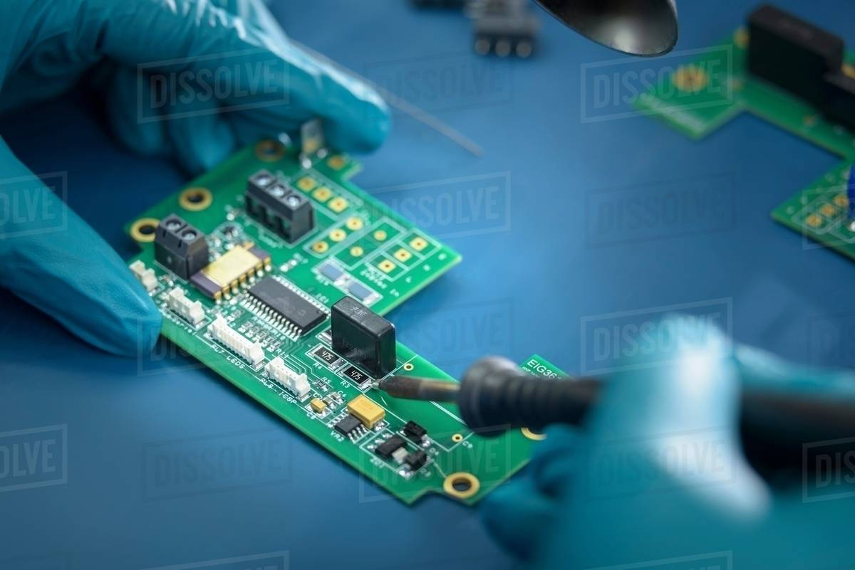 worker soldering circuit board in electronics factory close up rh dissolve com