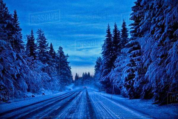 Empty snow covered highway at dusk, Hemavan, Sweden Royalty-free stock photo