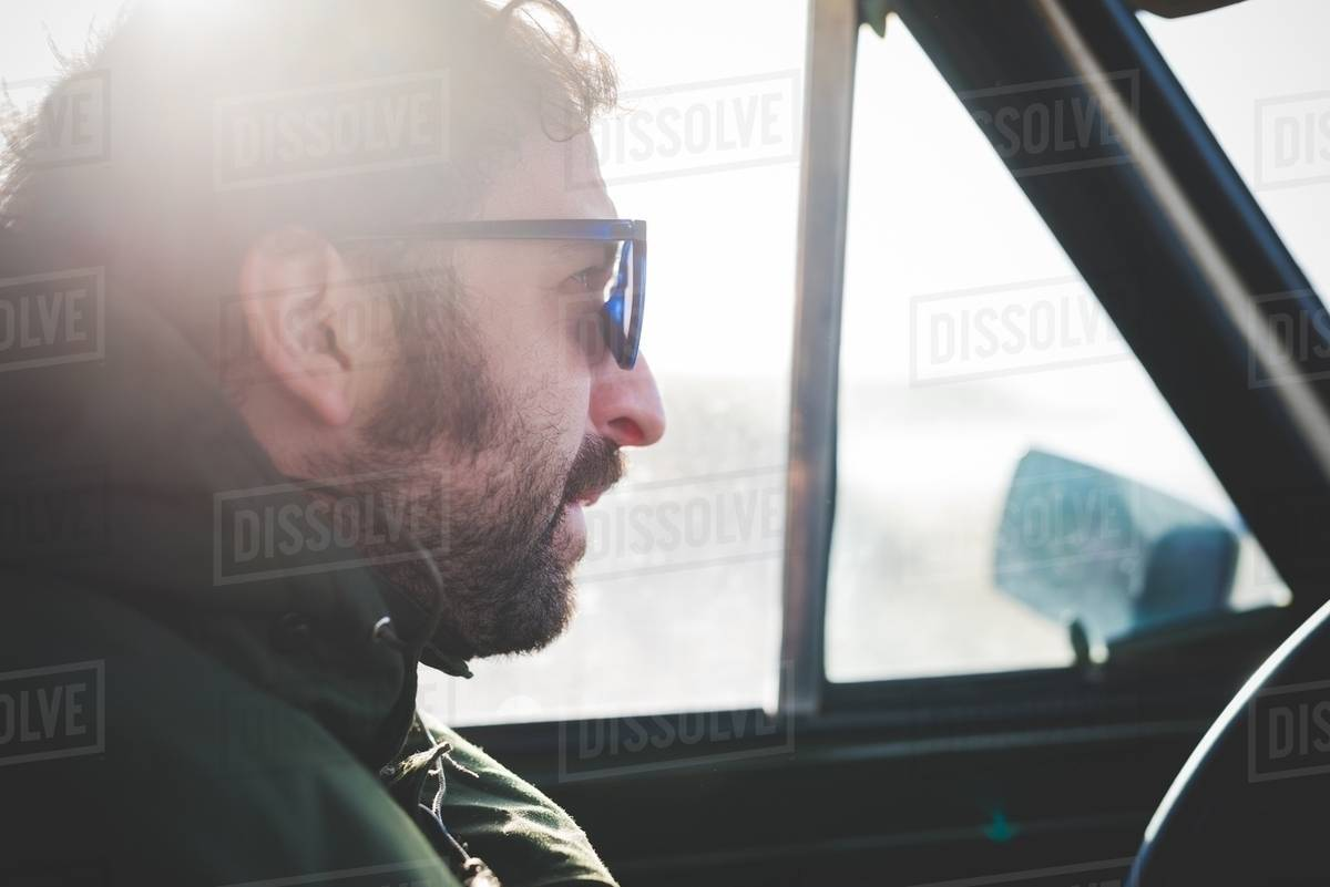 fdb918ac6c7d Close up of mid adult man wearing sunglasses in sunlit car - Stock ...