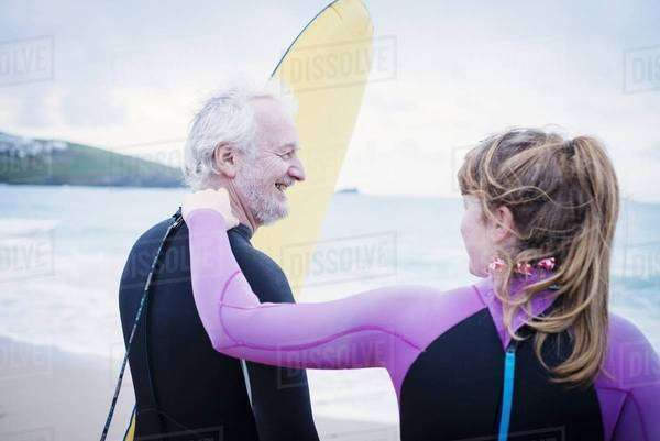 Father and daughter with surfboard on beach Royalty-free stock photo
