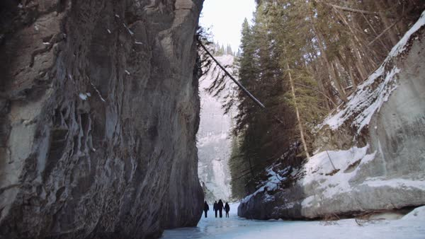 Wide-angle shot of people walking on ice in Grotto Canyon Royalty-free stock video