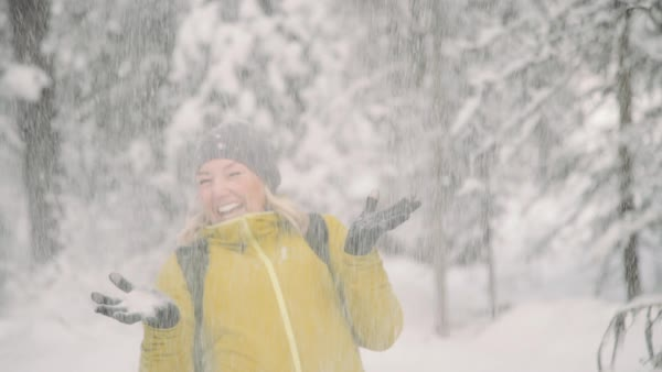 Medium shot of snow falling onto a woman Royalty-free stock video
