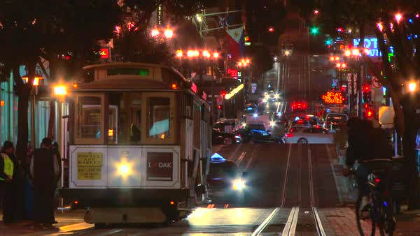 San Francisco California cable car trolley travels down union square, spins around on turntable and back up street at night. Royalty-free stock video