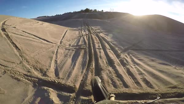 Motocross dirt bike sand dunes corner and jump - helmet cam Royalty-free stock video