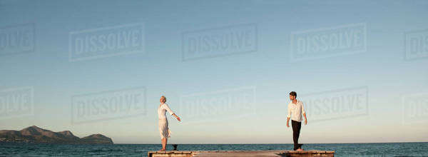 Couple standing on pier Royalty-free stock photo