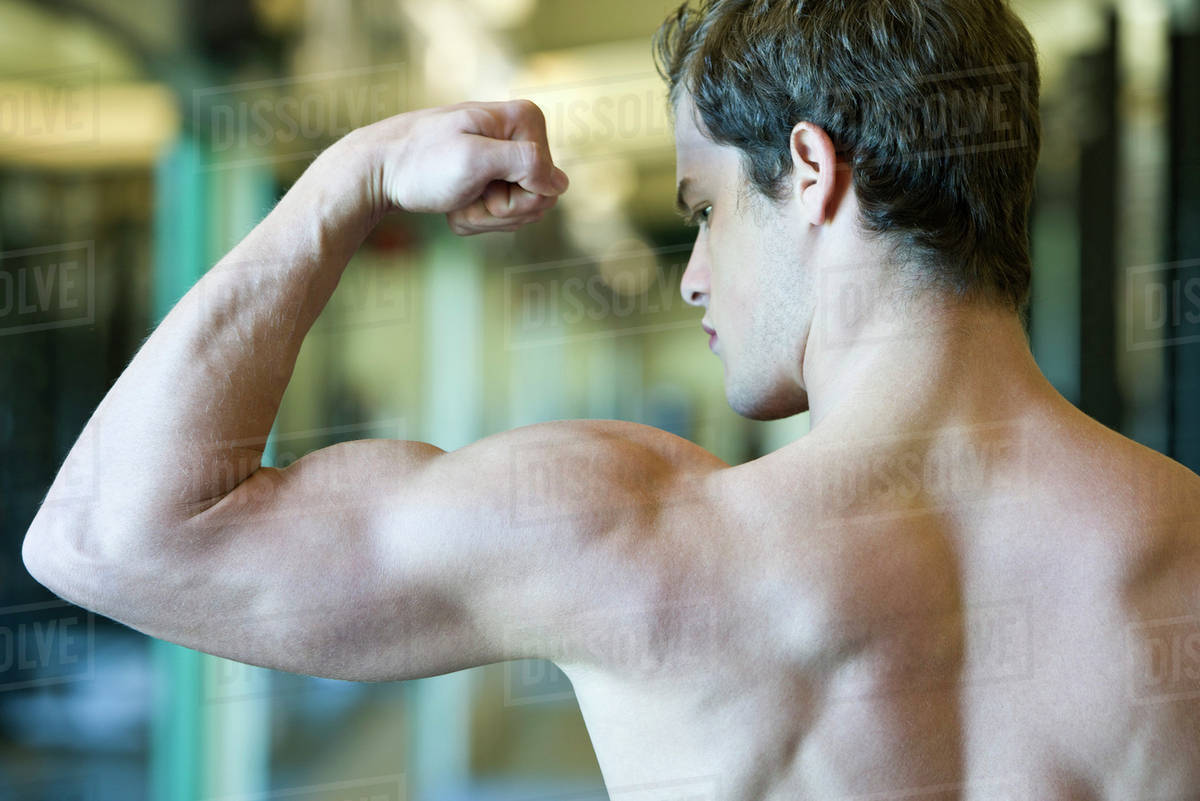 Young Man Flexing Bicep Muscles Stock Photo Dissolve