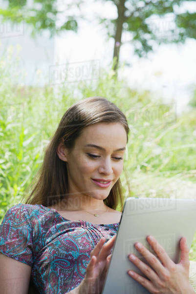 Woman using digital tablet outdoors Royalty-free stock photo