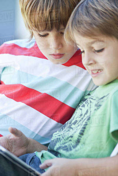 Boys using digital tablet Royalty-free stock photo