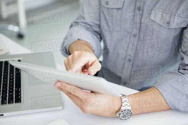 Using digital tablet with touch screen Royalty-free stock photo