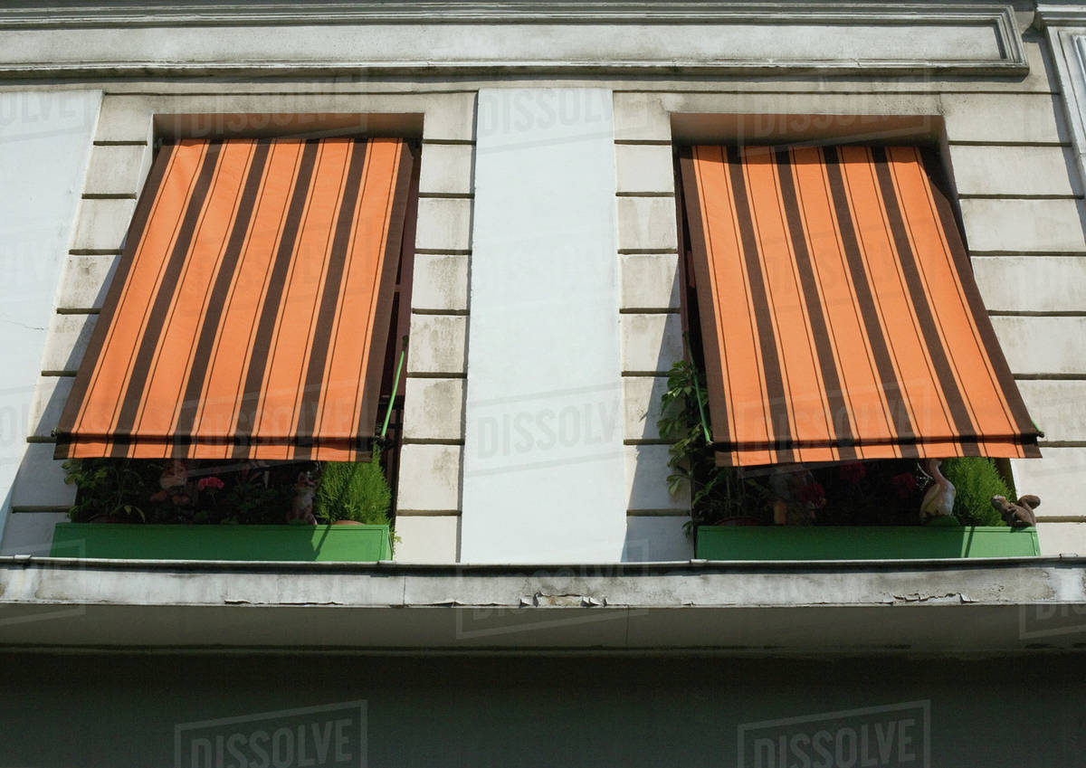 Two Striped Awnings Pulled Down Over Windows Low Angle View