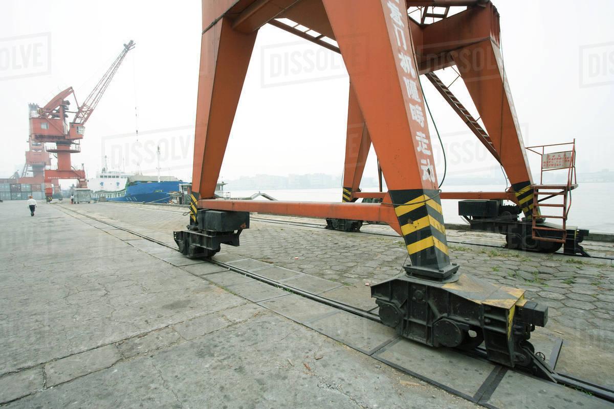 Loading crane on rails in shipyard stock photo