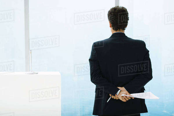 Businessman preparing to give speech, looking out of window Royalty-free stock photo