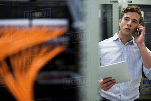Computer technician performing maintenance check of mainframe equipment Royalty-free stock photo