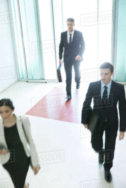 Business professionals arriving for another day of work Royalty-free stock photo