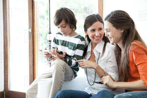 Family using digital tablet together Royalty-free stock photo