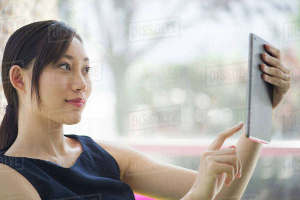 Woman using digital tablet Royalty-free stock photo