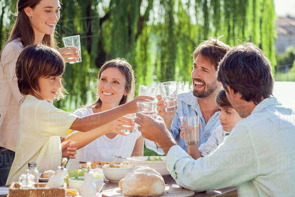 Family enjoying breakfast together outdoors Royalty-free stock photo