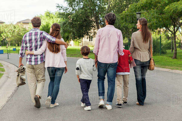 Family walking together in street, rear view Royalty-free stock photo