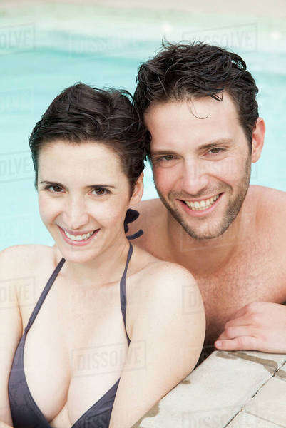 Couple relaxing together in pool, portrait Royalty-free stock photo