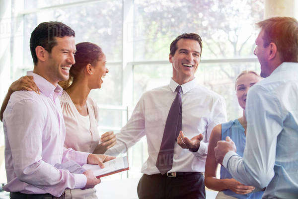 Colleagues having laugh together in office Royalty-free stock photo