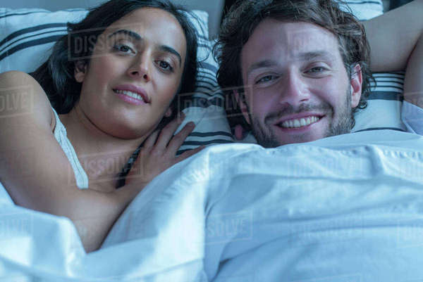 Couple together in bed, portrait Royalty-free stock photo