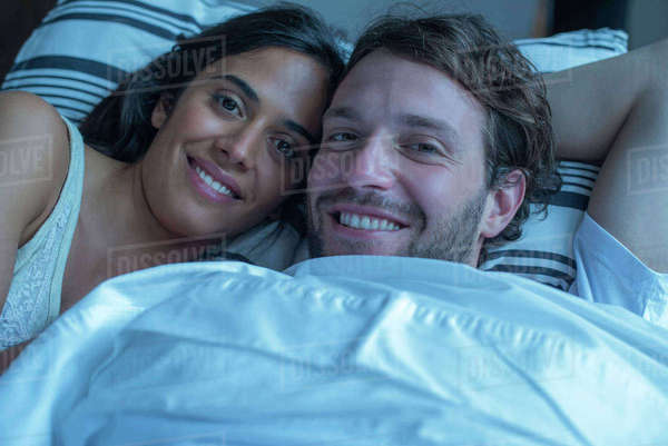 Couple in bed together, portrait Royalty-free stock photo