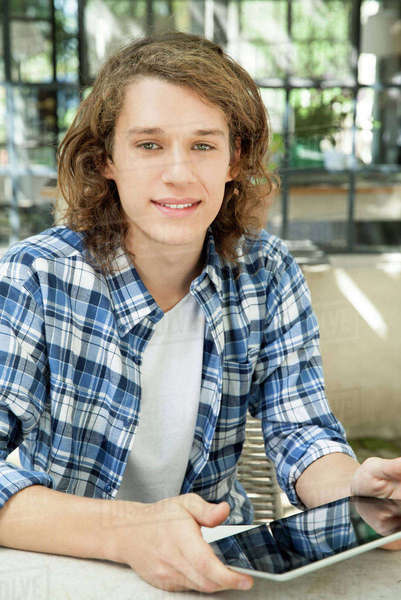 Young man using digital tablet outdoors Royalty-free stock photo