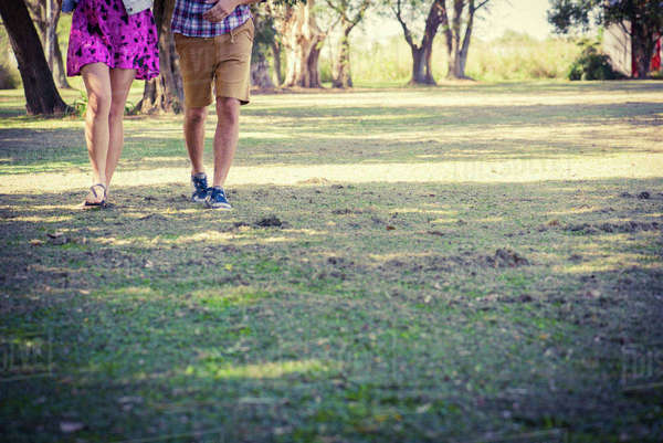 38918be2720117 Couple walking in park Royalty-free stock photo