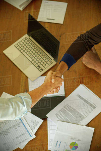 Business associates shaking hands during meeting Royalty-free stock photo