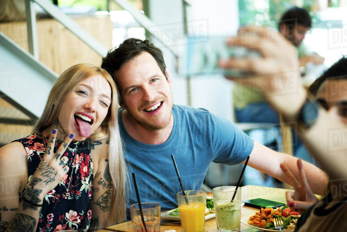 Couple Posing For Selfie In Restaurant