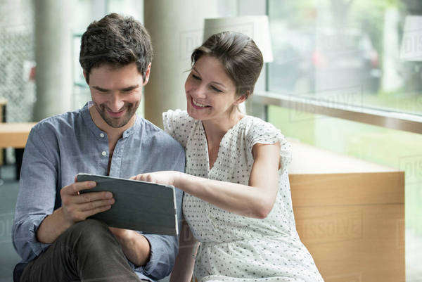 Couple using digital tablet together at home Royalty-free stock photo