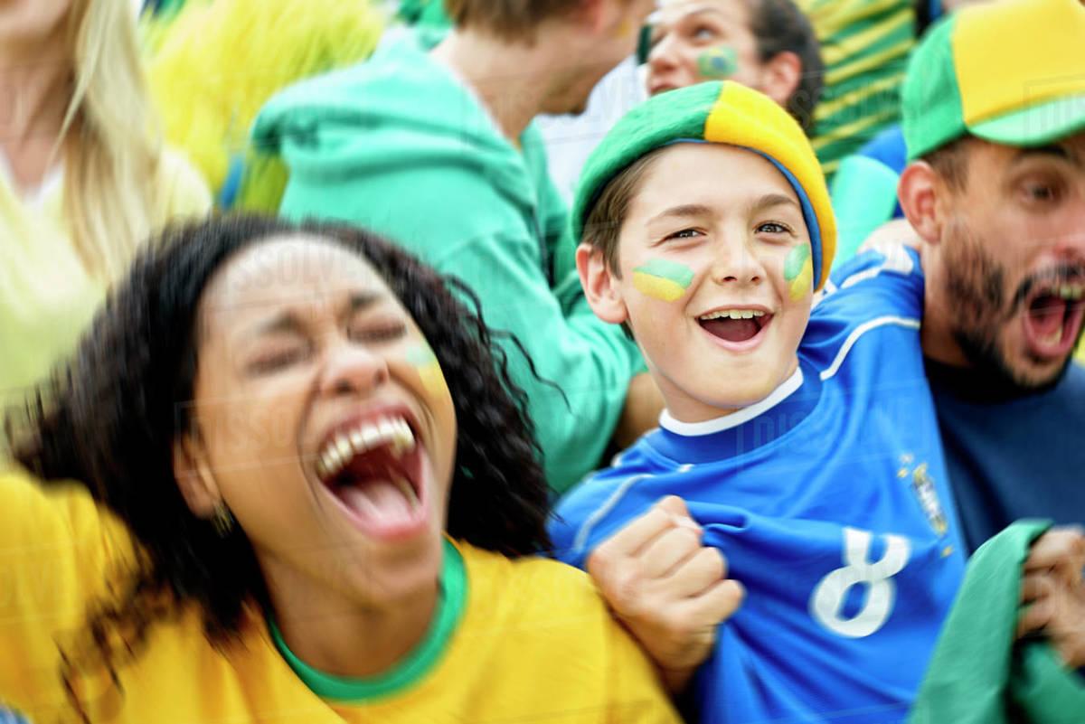 Brazilian football fans watching football match Royalty-free stock photo