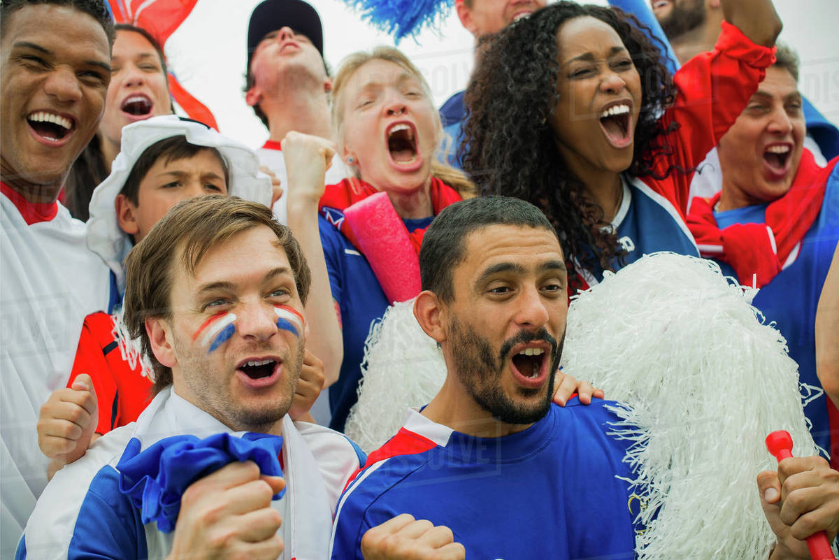 French Football Fans Cheering At Match Stock Photo Dissolve