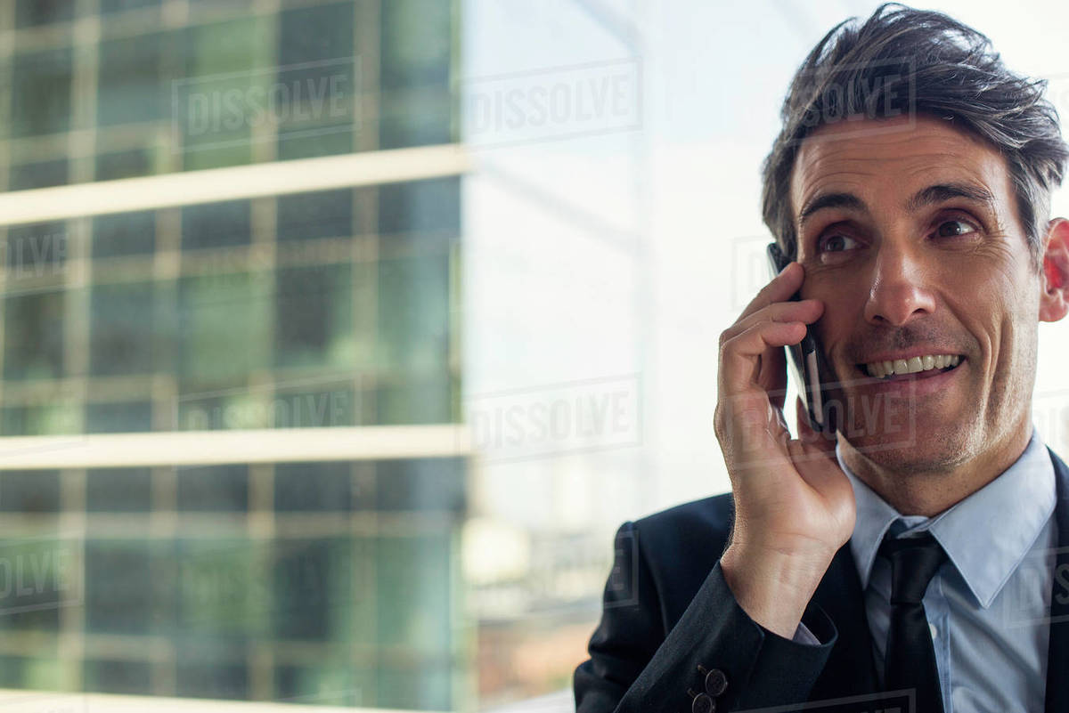 Businessman talking on mobile phone Royalty-free stock photo