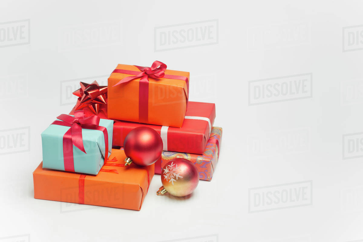 Festively wrapped Christmas gifts - Stock Photo - Dissolve