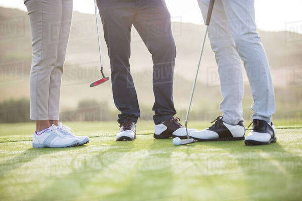 Friends standing on golf course Royalty-free stock photo