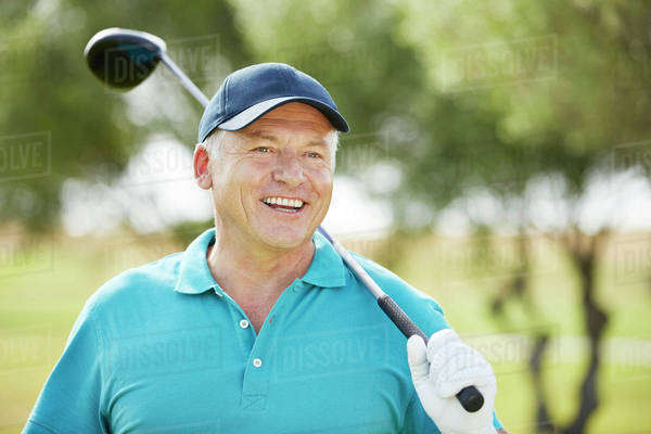 Senior man holding golf club Royalty-free stock photo