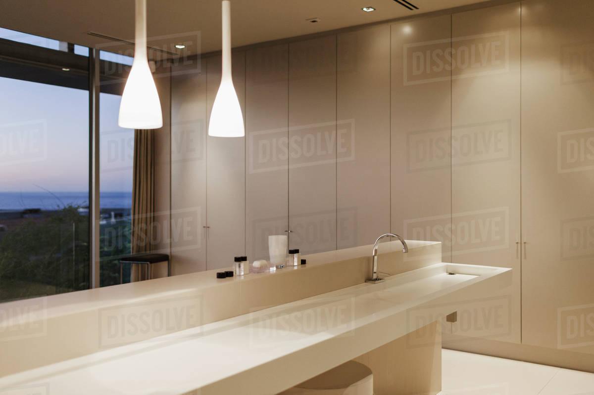 Sink and pendant lights in modern bathroom - Stock Photo - Dissolve