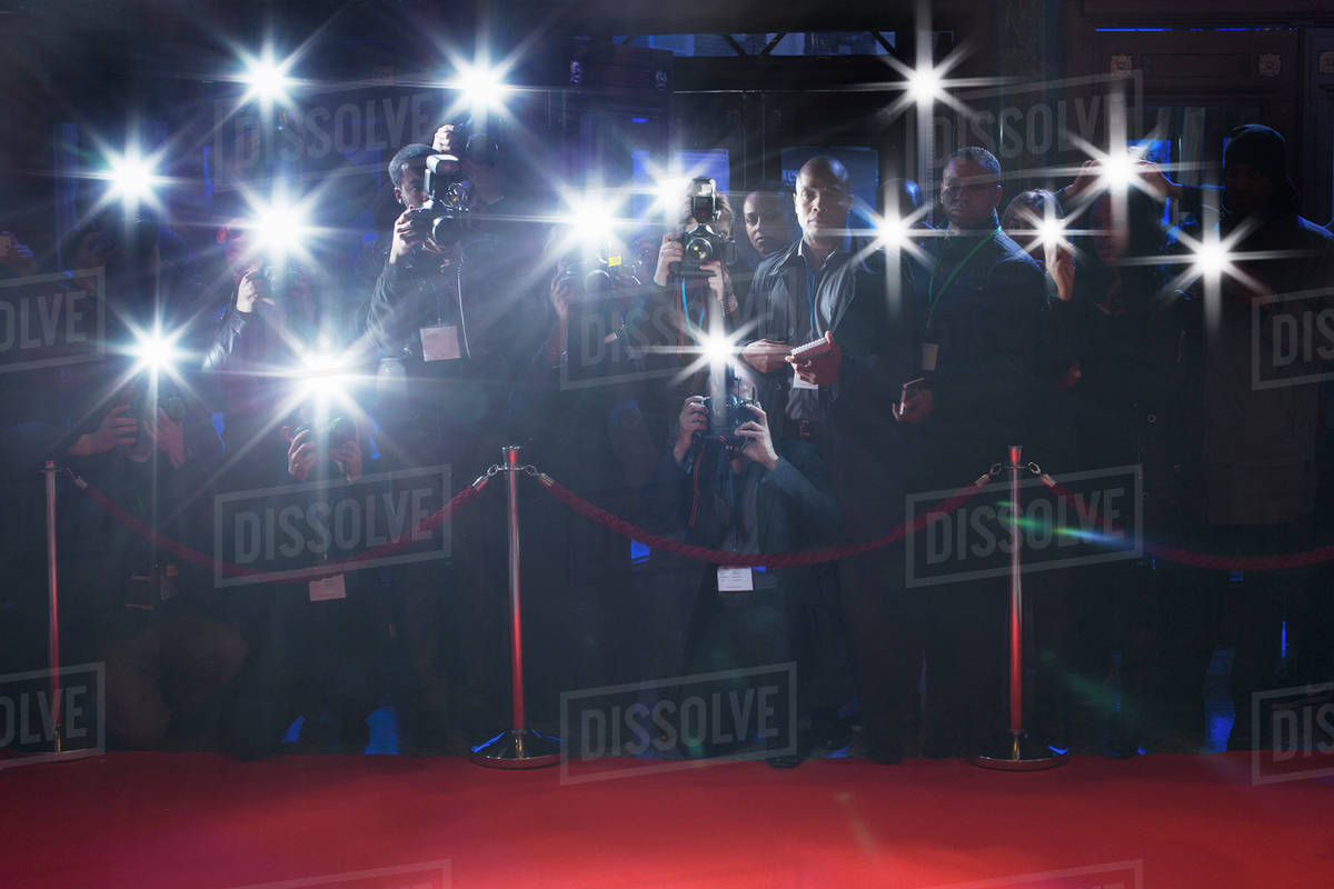 Paparazzi using flash photography behind rope on red carpet Royalty-free stock photo