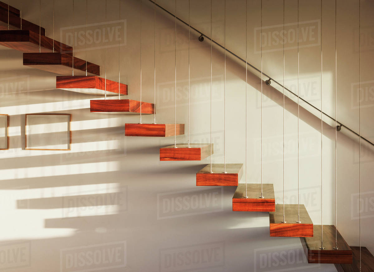 Shadows on floating staircase in modern house