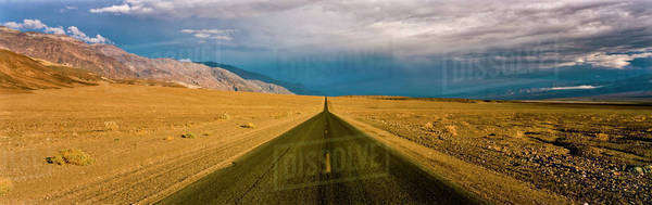 Rural road in desert landscape Royalty-free stock photo