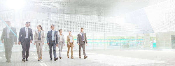 Business people walking in modern courtyard Royalty-free stock photo