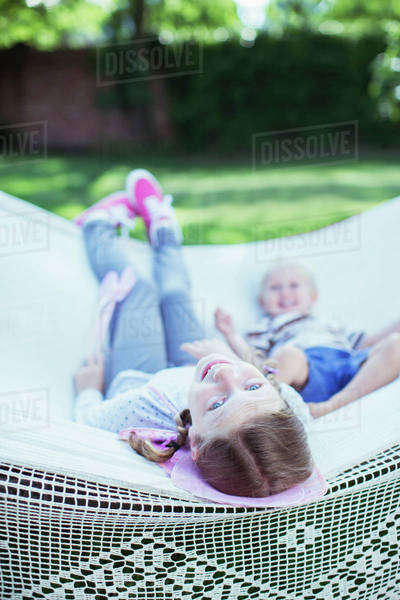 Children relaxing in hammock outdoors Royalty-free stock photo