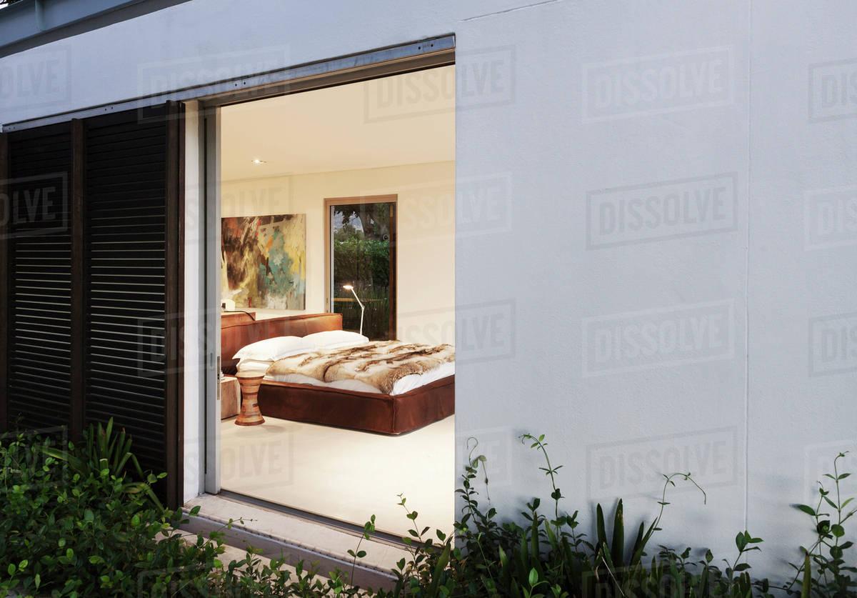 Sliding Door Open To Modern Bedroom Stock Photo Dissolve