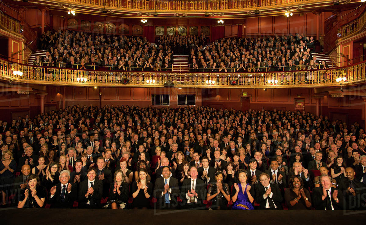 Audience applauding in theater Royalty-free stock photo