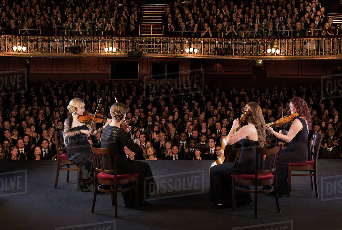 Quartet performing on stage in theater Royalty-free stock photo