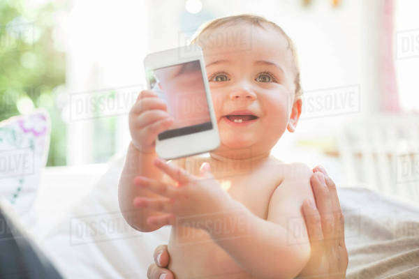 Baby boy playing with cell phone Royalty-free stock photo